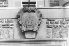 Photograph of a crest on the Henry Hicks Arts & Administration Building