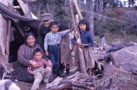 Photograph of a Naskapi family outside of their tent in Davis Inlet, Newfoundland and Labrador