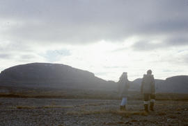 Photograph of Barbara Hinds and Allie walking in Cape Dorset, Northwest Territories