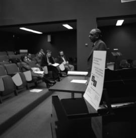 Photograph of an unidentified person giving a lecture at the Dalhousie Arts Centre