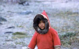 Photograph of a child with a red coat in Cape Dorset, Northwest Territories