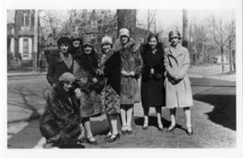 Photograph and a photographic negative of eight students and alumnae