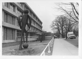 "Photograph of a sculpture called ""20th Century Student"" in front of the Student Union B..."