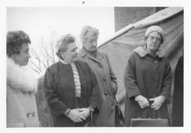 Photograph of four people at the Cornerstone Ceremony - outside CNA House in Ottawa