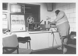 Photograph of an unidentified person in a television studio