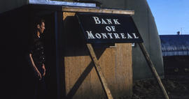Photograph of a man at the Bank of Montreal in Frobisher Bay, Northwest Territories