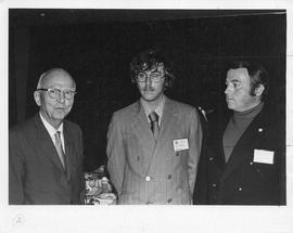 Photograph of Ian Campbell, Brian Smith, and an unidentified person