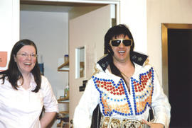 Photograph of Librarian Shelley McKibbon and Elvis impersonator