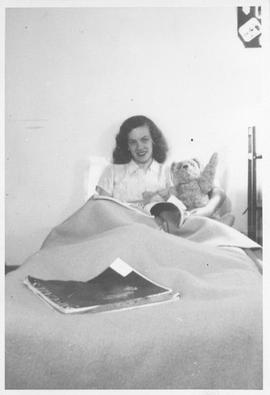 Photograph of an unidentified person sitting in bed