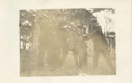 Postcard with a photograph of six unidentified people at a Dalhousie reunion