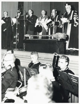 Photograph of ceremony with a band playing