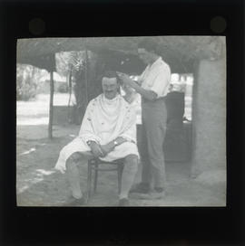 Photograph of a person getting a haircut