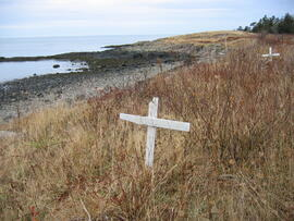 Photograph of two white crosses on the beach at Whites Point, Digby Neck, Nova Scotia