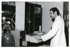 Photograph of Harold W. Cook with equipment