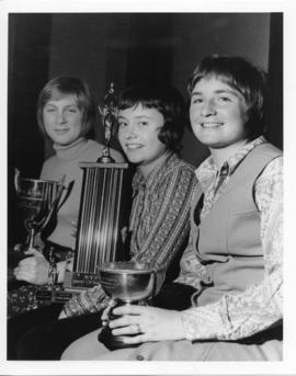 Photograph and a photographic negative of three female athletes