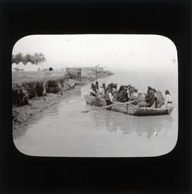 Photograph of a group of people in a rowboat