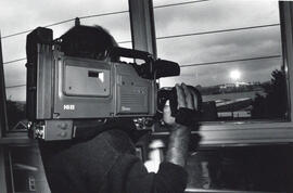 Photograph of person with a video camera