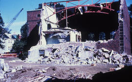 Photograph of the demolition of the Medical-Dental Library, side of building torn down