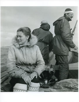 Photograph of Barbara Hinds and two men on a boat