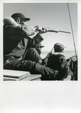 Photograph of Eetuk shooting seal in Frobisher Bay, Northwest Territories