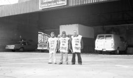 Photograph of three members of CUPE 1392 on strike