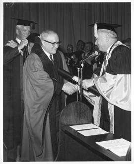 Photograph of Henry Hicks conferring an honorary degree on an unidentified person