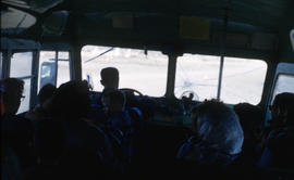 Photograph of several people on a bus near Frobisher Bay, Northwest Territories