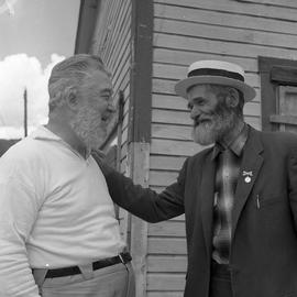 Photograph of Ralph Dunn and Black Mike standing together in Dawson City, Yukon