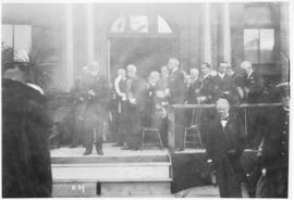 Photograph of an unidentified person speaking on the front steps on Halifax city hall