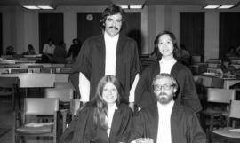 Photograph of four law students at an award presentation