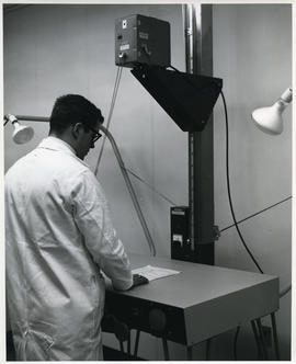 Photograph of D.A. Gibson with audio-visual equipment