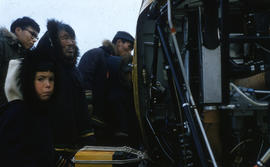 Photograph of people looking at a helicopter in Cape Dorset, Northwest Territories