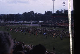 Photograph of a football field with a marching band