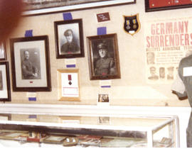 Photograph of a museum display of artifacts and portraits of the Royal Winnipeg Rifles Regiment