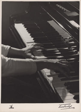 Publicity photograph of Ellen Ballon's hands on a keyboard