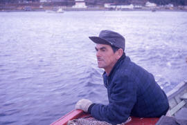 Photograph of a man on a boat in Postville, Newfoundland and Labrador