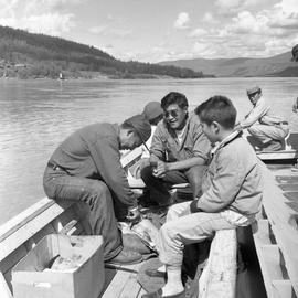 Photograph of Arthur Percy, an unidentified man, and a boy on a boat on the Yukon River