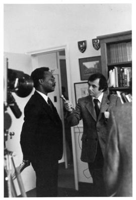Photograph of Dr. Jide Osuntokun and reporter