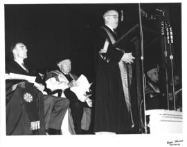 Photograph of A. E. Kerr giving an address at a ceremony