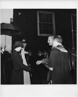Photograph of Princess Elizabeth and the Duke of Edinburgh being greeted by Lieutenant-Colonel K....