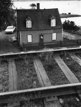 Photograph of a boarded-up house in Africville