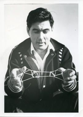 Photograph of George Koneak playing cat's cradle in Fort Chimo, Quebec