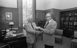 Photograph of Oland's presenting a cheque to Henry Hicks