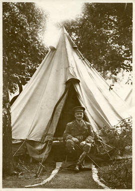 Officer sitting in front of his tent