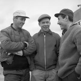 Photograph of Luke Dumas, Jacques Dumas, and George Koneak talking together in Fort Chimo, Quebec