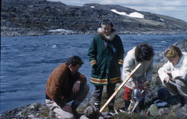 Photograph of Barbara Hinds and three other people making tea outdoors in Frobisher Bay, Northwes...