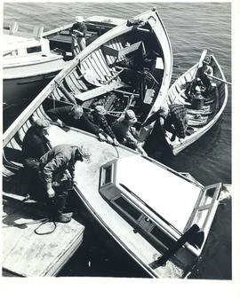 Photograph of lobstermen salvaging a sunken boat at Seal Island, off Cape Sable Island