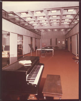 Photograph of a piano and tables in the Killam Memorial Library