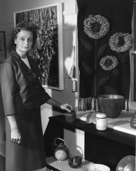 Photograph of Evelyn Holmes with pottery