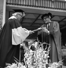 Photograph of a degree being awarded at the Dalhousie medical centennial convocation ceremony